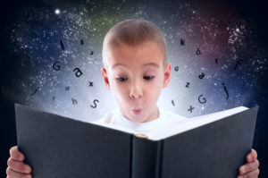 Boy discovering the magic of reading.